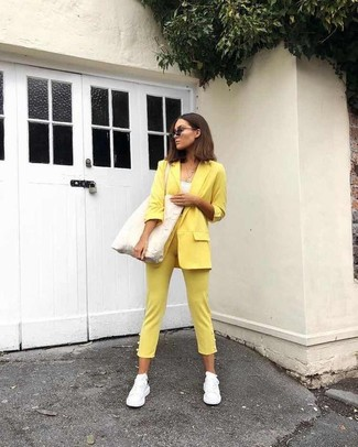 How to wear: yellow blazer, white tank, yellow skinny pants, white athletic shoes