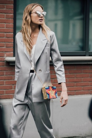 A grey satin blazer and grey satin tapered pants is a great combination to carry you throughout the day.