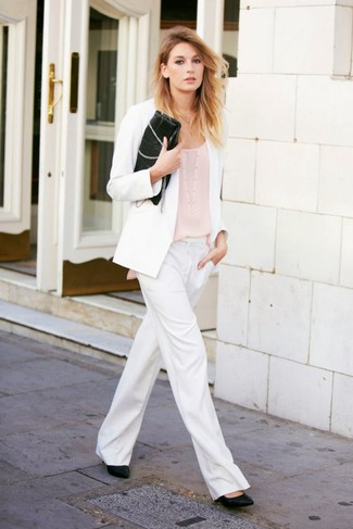 White Blazer Outfits For Women: A white blazer and white wide leg pants are an easy way to inject some chic into your daily off-duty repertoire. Black leather pumps make your look complete.