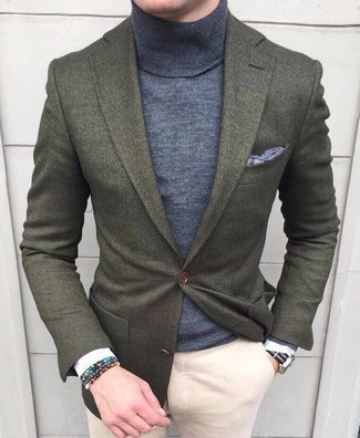 How to wear: olive wool blazer, grey turtleneck, beige chinos, grey pocket square