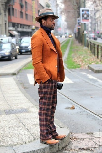 Men's Outfits 2020: The ultimate foundation for a killer and effortlessly sophisticated ensemble? An orange blazer with navy plaid chinos.