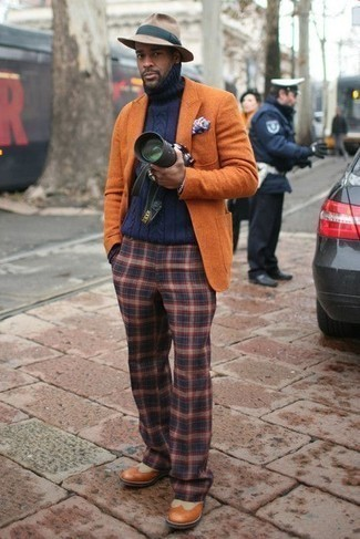 Men's Outfits 2020: This classic and casual pairing of an orange blazer and navy plaid chinos is extremely easy to throw together in seconds time, helping you look seriously stylish and prepared for anything without spending too much time going through your closet. Serve a little outfit-mixing magic by wearing tobacco leather brogue boots.