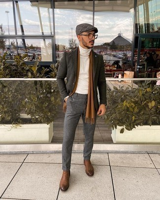 Brown Leather Chelsea Boots Outfits For Men: A charcoal wool blazer and grey wool chinos are appropriate for both dressy occasions and daily wear. Why not take a more sophisticated approach with footwear and add a pair of brown leather chelsea boots to the mix?