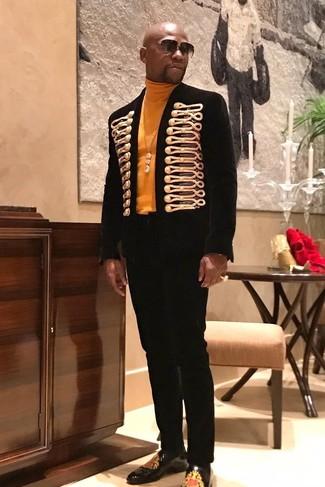 How to wear: black and gold embroidered blazer, orange turtleneck, black dress pants, black print leather loafers