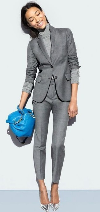 How to Wear a Blue Leather Crossbody Bag In Warm Weather: Make a grey blazer and a blue leather crossbody bag your outfit choice for a casual getup with a twist. Add silver leather pumps to the mix to easily dial up the glam factor of your ensemble.