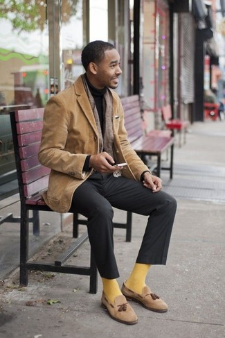 How to Wear a Black Turtleneck For Men: Reach for a black turtleneck and charcoal dress pants for elegant style with a modern spin. If not sure about the footwear, complement this ensemble with a pair of tan suede tassel loafers.