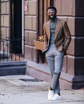 How to Wear a Grey Turtleneck For Men: One of the best ways to style such a must-have piece as a grey turtleneck is to wear it with grey dress pants. You know how to tone down this look: white canvas low top sneakers.