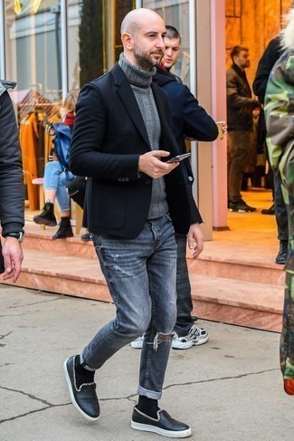 How to Wear Black Leather Slip-on Sneakers For Men: Such pieces as a black blazer and grey ripped jeans are an easy way to introduce effortless cool into your casual repertoire. Infuse your look with a touch of refinement with a pair of black leather slip-on sneakers.