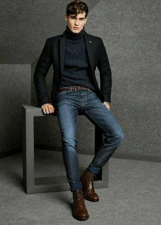 A black wool blazer and navy jeans are a great outfit formula to have in your arsenal. To break out of the mold a little, go for a pair of dark brown leather dress boots.