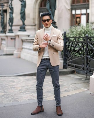 Brown Leather Chelsea Boots Outfits For Men: This smart casual combination of a beige blazer and charcoal jeans is extremely easy to put together without a second thought, helping you look seriously stylish and prepared for anything without spending too much time digging through your closet. If you want to instantly step up your outfit with a pair of shoes, why not introduce brown leather chelsea boots to your getup?