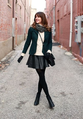 Pairing a dark green blazer jacket with a black leather skater skirt is a comfortable option for running errands in the city. Let's make a bit more effort now and make black leather ankle boots your footwear choice.