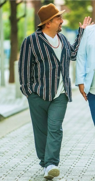 How to Wear a Navy Vertical Striped Blazer For Men: If the occasion calls for a polished yet knockout outfit, pair a navy vertical striped blazer with dark green chinos. Kick up the appeal of this getup by slipping into a pair of white leather low top sneakers.