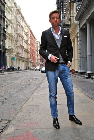 A smart casual combination of a grey v-neck pullover and blue jeans can maintain its relevance in many different circumstances. Why not introduce black leather derby shoes to the mix for an added touch of style?