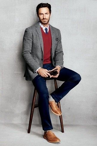 Stand out among other stylish civilians in a grey wool blazer and navy chinos. Balance this look with brown leather brogues. Nothing like a cool outfit to cheer up a gloomy autumn afternoon.