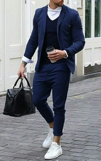 How To Wear a Navy Blazer With a Blue V-neck Sweater For Men: This smart combo of a navy blazer and a blue v-neck sweater is super easy to put together without a second thought, helping you look dapper and prepared for anything without spending too much time going through your closet. Clueless about how to finish? Introduce white leather low top sneakers to the equation to jazz things up.