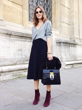 Pairing a black blazer jacket with a black full skirt is a comfortable option for running errands in the city. Why not introduce dark purple suede ankle boots to the mix for an added touch of style?