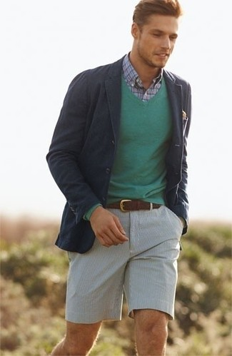 Consider wearing a navy cotton blazer and seersucker shorts for a work-approved look. A cool getup like this one is just what you need on a summer afternoon.