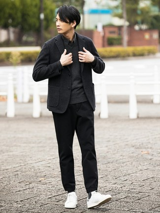 A black long sleeve shirt and black chinos is a smart pairing to carry you throughout the day. If you don't want to go all out formal, opt for a pair of white leather low top sneakers. You can bet this getup is great when colder weather arrives.