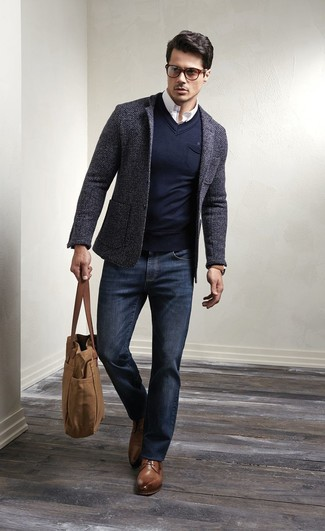 Stand out among other stylish civilians in a charcoal wool suit jacket and dark blue jeans. Go for a pair of brown leather derby shoes for a masculine aesthetic.