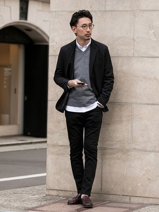 How to Wear Black Jeans For Men: This combination of a black blazer and black jeans is definitive proof that a pared down ensemble doesn't have to be boring. Complete your ensemble with dark brown leather loafers to completely switch up the outfit.