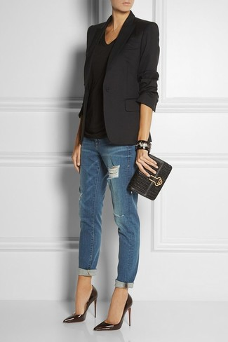 A black jacket and navy distressed boyfriend jeans are a great outfit formula to have in your arsenal. Black leather pumps will add a touch of polish to an otherwise low-key look.