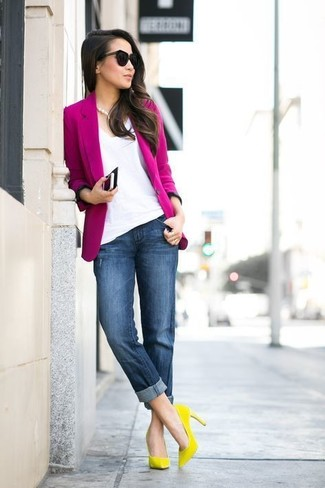 How to Wear a Hot Pink Blazer For Women: For chic style without the need to sacrifice on comfort, we turn to this pairing of a hot pink blazer and navy boyfriend jeans. Introduce a pair of yellow suede pumps to the mix to effortlesslly boost the glamour factor of any outfit.