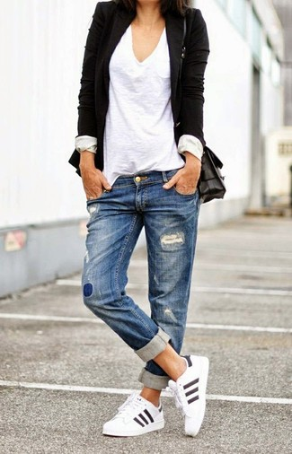 Marry a black blazer with bottom if you're on the hunt for an outfit idea for when you want to look casually cool. White athletic shoes will add a new dimension to an otherwise classic getup. This getup is absolutely great to welcome the springtime.