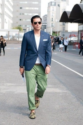 How to Wear a Black Leather Bracelet For Men: A navy blazer and a black leather bracelet make for the ultimate casual style for any modern man. Tap into some David Beckham dapperness and complement this ensemble with a pair of olive camouflage canvas loafers.