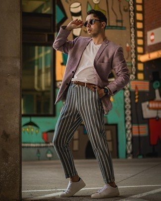 1200+ Outfits For Men In Their 30s: This getup clearly shows it is totally worth investing in such menswear pieces as a purple blazer and navy vertical striped chinos. Complete your look with white leather low top sneakers to serve a little mix-and-match magic. This combination demonstrates how young guys succeed in the fashion department.