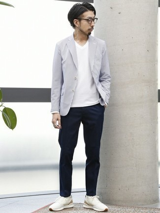 Grey Vertical Striped Blazer Outfits For Men: A classic and casual combo of a grey vertical striped blazer and navy chinos is relevant in a myriad of occasions. You could perhaps get a bit experimental on the shoe front and play down your outfit by slipping into a pair of white athletic shoes.