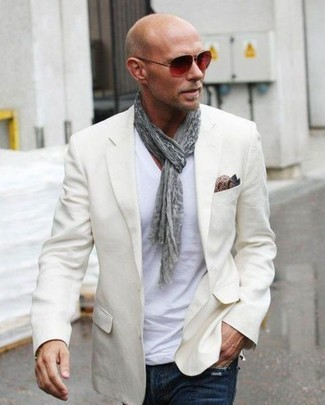 How to wear: beige blazer, white v-neck t-shirt, navy jeans, brown paisley silk pocket square