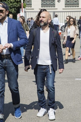 How to Wear a Navy Wool Blazer For Men: As you can see, it doesn't take that much time for a man to look dapper. Try teaming a navy wool blazer with navy jeans and you'll look incredibly stylish. Clueless about how to finish? Introduce a pair of white leather low top sneakers to the mix for a more casual vibe.