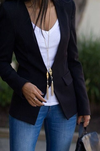 Consider wearing a black blazer and a rucksack for a refined yet off-duty ensemble. With rising temperatures comes spring and the need for a #{cool} look just like this one.