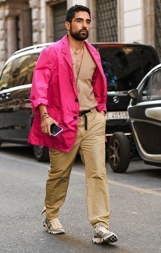 How to Wear a Black Canvas Belt For Men: When comfort is paramount, wear a hot pink blazer with a black canvas belt. The whole ensemble comes together when you complete this look with a pair of beige athletic shoes.