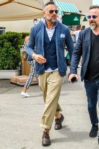 Dark Green Sunglasses Outfits For Men After 40: For a laid-back ensemble, marry a navy and white vertical striped blazer with dark green sunglasses — these two pieces work nicely together. For a dressier take, why not complement your ensemble with dark brown leather brogues? This getup suggests how to stay stylish as you get into your 40s.