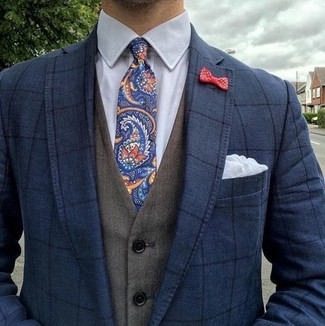 How to wear: navy check blazer, olive waistcoat, white dress shirt, navy paisley tie