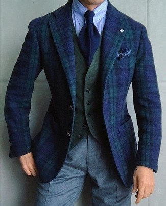 Consider teaming a navy and green plaid blazer with grey wool dress pants to ooze class and sophistication. We love how great this one is for summer-to-fall weather.