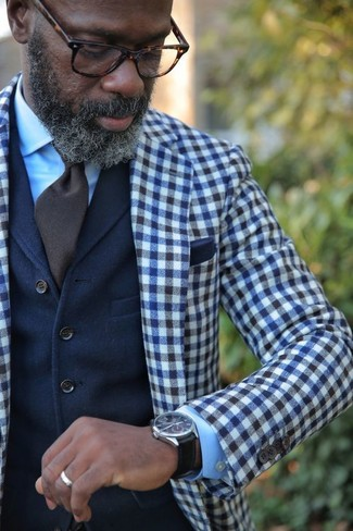 How to wear: navy and white gingham wool blazer, navy wool waistcoat, light blue dress shirt, dark brown tie