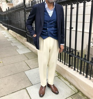 How to wear: navy blazer, navy waistcoat, light blue dress shirt, white dress pants