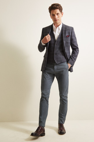 How to Wear a White Dress Shirt For Men: You'll be amazed at how very easy it is for any gentleman to get dressed this way. Just a white dress shirt worn with charcoal chinos. Infuse your ensemble with a dose of polish with dark brown leather oxford shoes.