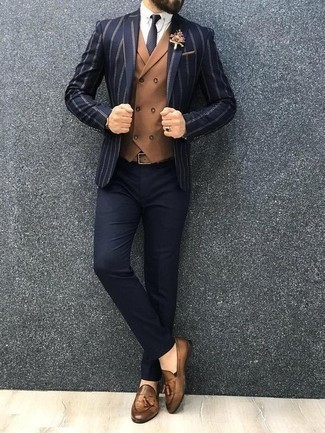 How to Wear a Navy Vertical Striped Blazer For Men: Teaming a navy vertical striped blazer with navy dress pants is a good option for a sharp and sophisticated look. Tan leather tassel loafers look great here.