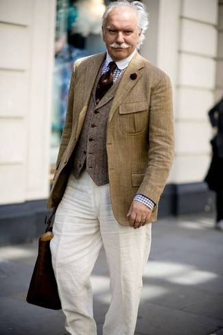 Fashion for Men Over 60: What To Wear: Pair a tan linen blazer with white linen dress pants to look like a sharp gent. This getup is most probably what you're looking for as a 60-year-old gentleman.