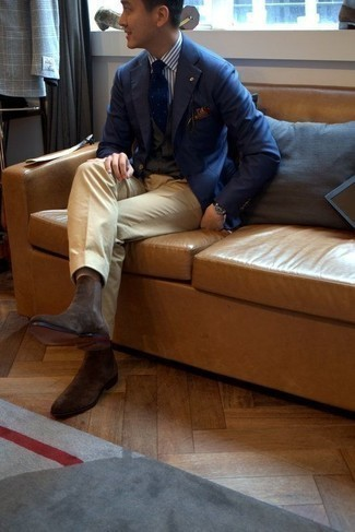 How to Wear a White and Brown Vertical Striped Dress Shirt For Men: Consider wearing a white and brown vertical striped dress shirt and khaki dress pants for seriously smart attire. Want to play it down when it comes to shoes? Introduce a pair of dark brown suede chelsea boots to this getup for the day.