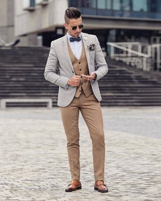 Polka Dot Bow-tie Outfits For Men: A grey blazer and a polka dot bow-tie are essential in any man's functional off-duty arsenal. Tobacco leather double monks add a classy aesthetic to the outfit.