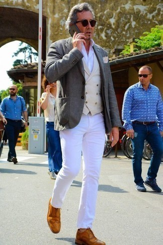 How to Wear a Beige Waistcoat: This combination of a beige waistcoat and white jeans embodies rugged refinement. When it comes to shoes, this getup pairs brilliantly with tobacco leather brogues.