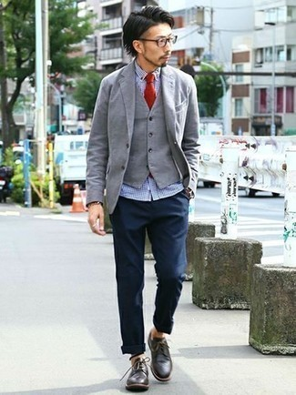 How to Wear a Grey Waistcoat: A grey waistcoat and navy chinos are a polished ensemble that every stylish guy should have in his sartorial arsenal. If not sure about what to wear when it comes to footwear, stick to a pair of black leather derby shoes.