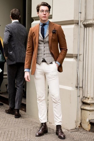 How to Wear a Brown Leather Watch For Men: Combining a tobacco blazer and a brown leather watch will prove your prowess in menswear styling even on lazy days. Complete this outfit with a pair of dark brown leather casual boots for a masculine aesthetic.