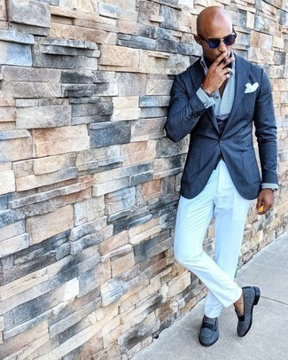 Navy Waistcoat Outfits: You're looking at the indisputable proof that a navy waistcoat and white chinos look awesome if you pair them together in a polished outfit for today's gentleman. Throw in blue canvas loafers et voila, the outfit is complete.