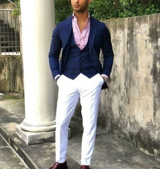 Navy Waistcoat Outfits: A modern gent's elegant collection should always include such essentials as a navy waistcoat and white dress pants. A trendy pair of burgundy leather double monks is a simple way to add an air of stylish nonchalance to your ensemble.