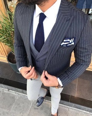 Waistcoat Outfits: For an ensemble that's sophisticated and gasp-worthy, pair a waistcoat with grey chinos. Black fringe leather loafers tie the ensemble together.
